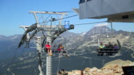 Chairlifts moving located high on the mountain