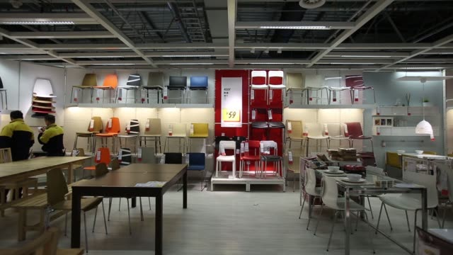 Chairs on display inside the Ikea Beijing Xihongmen Store operated by Ikea AB in Beijing China on Monday March 9 Ikea employees working in the dining...