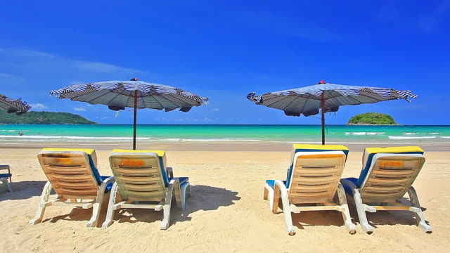 Chairs with white sand beach and sea