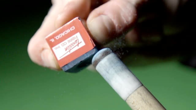 Chalking a snooker cue, slow motion