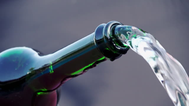 Champagne bottle pouring water