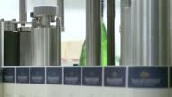 MS champagne bottles Lable on production line / Ayl, Rhineland-Palatinate, Germany