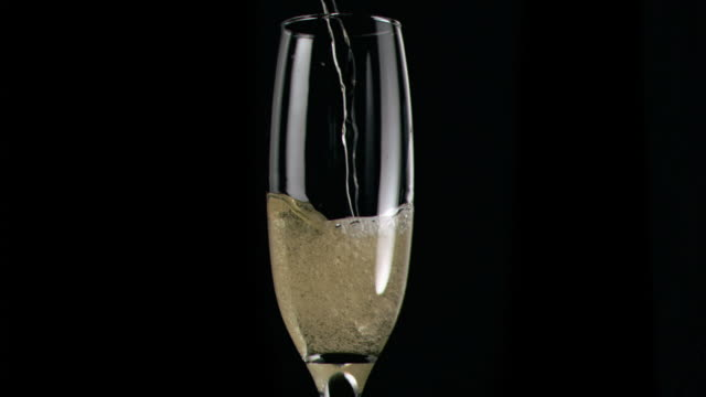 Champagne poured in super slow motion