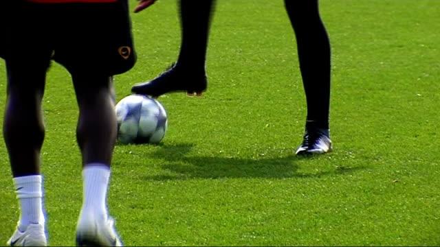 Arsenal squad training Panup shots of Walcott Nasri Arshavin and Bendtner Adebayor running Wenger watching from sidelines Closeup of Eduardo Van...