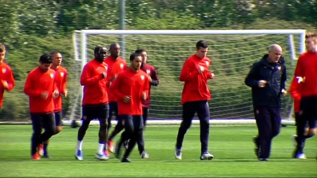 Arsenal squad training Wenger running with ball Group running shot Arshavin running with group Wenger talks to Pat Rice Arshavin talking to Cesc...