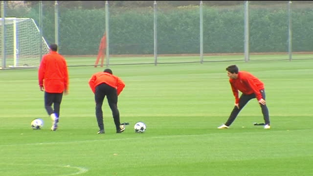 Arsenal squad training Wenger watches players train including Fabregas Silvestre Arsenal players playing training game