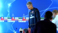 Arsenal training ahead of FC Porto match INT Arsene Wenger arriving at press conference and taking seat