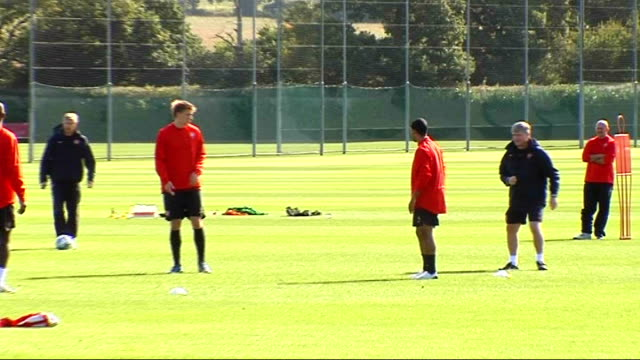 Arsenal training ahead of FC Porto match More of Arsenal players training including midshot of Theo Walcott