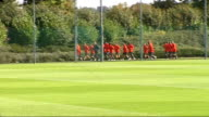 Arsenal training ahead of FC Porto match Players jogging and doing warmup exercises during training including Samir Nasri Gael Clichy Kolo Toure...