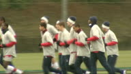 Arsenal training ENGLAND Hertfordshire London Colney GVs Arsenal footballers jogging in warmup Focus shots on players including Abou Diaby Cesc...