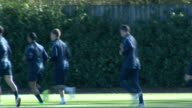 Champions' League Arsenal training Wenger and Assistant Manager Pat Rice / Vermaelen and Colbert training / players jogging along / Aaron Ramsey Theo...