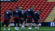 Liverpool training ENGLAND Liverpool Anfield EXT Liverpool players warming up on pitch as manager Rafael Benitez walking behind Players jogging round...