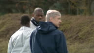 Arsenal train ahead of match with Barcelona ENGLAND Hertfordshire London Colney EXT Bacary Sagna and Emmanuel Eboue along on training pitch / Theo...