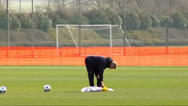 Arsenal squad training ENGLAND Hertfordshire London Colney EXT Closeup of Arsene Wenger with ball More of Wenger walking on training pitch Generic...