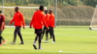 Arsenal squad training More generic training shots Emmanuel Adebayor training More generic training shots Theo Walcott training Closeup of Walcott...