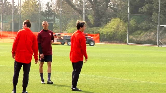 Arsenal squad training Wide shot of players training Samir Nasri training Aaron Ramsey training Wenger talking to unidentified member of staff Bakary...
