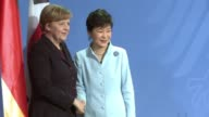 Chancellor Angela Merkel pledged Germanys support Wednesday during a visit by South Koreas president for efforts to unify the Korean peninsular...