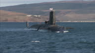 Chancellor George Osborne Announces Plans to Invest in Faslane Showing Faslane country side and naval base Chancellor George Osborne on speed boat...