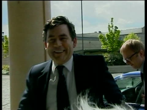 Chancellor Gordon Brown emerges from car and enters building during Edinburgh visit