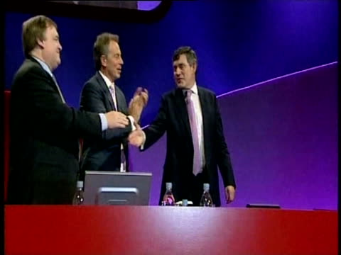 Chancellor Gordon Brown is greeted by Prime Minister Tony Blair after addressing delegates at party conference
