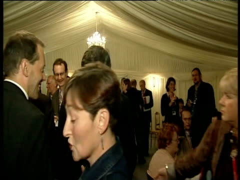 Chancellor Gordon Brown mingles with guests at party following annual conference