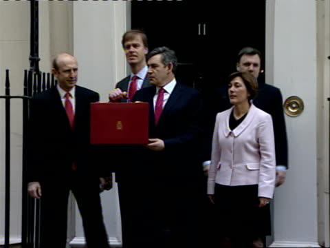 Chancellor Gordon Brown with red budget case outside number 11 / Gordon Brown balloon protest by Tories ENGLAND London Downing Street EXT **flash...