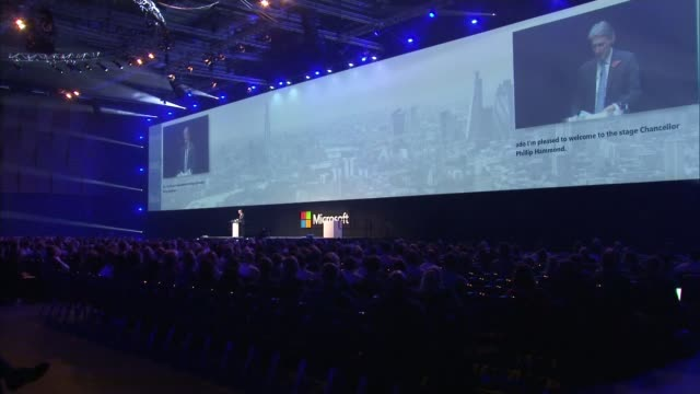 Chancellor outlines threat from foreign hackers ENGLAND London INT Philip Hammond MP onto stage at Microsoft event Philip Hammond MP speech SOT We...