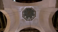 A chandelier hangs from a domed vault in the Umayyad Mosque Damascus. Available in HD.