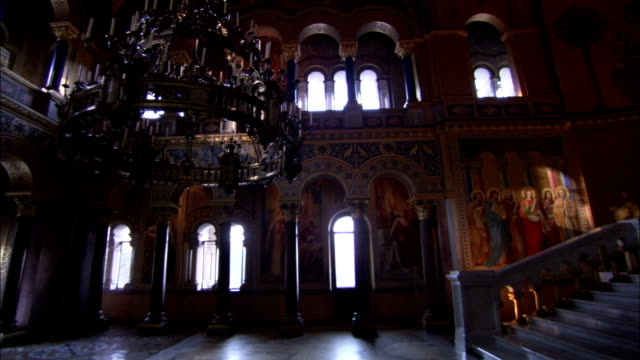 A chandelier hangs inside the Throne Hall of Neuschwanstein Castle. Available in HD.