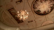 Chandeliers hang from the ceiling in Stowe House. Available in HD.
