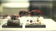 Chanel SA branded goods are displayed in the fashion label's new flagship store on New Bond Street in London Chanel sunglasses and accessories sit in...