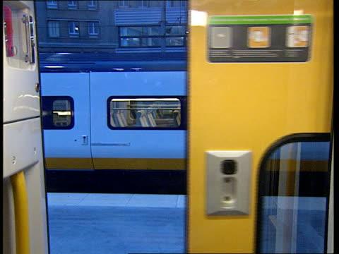 Channel Tunnel fare paying passenger services begin FRANCE Paris Gare Du Nord CMS Stewardess stamps passenger's ticket MS Passengers through gates...