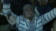 CU Chanting spectator in Tahrir Square during Mubarak's speech yelling wildly with fists in the air / Cairo Egypt