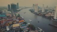 Chao Phraya River, aerial tracking shot through Bangkok