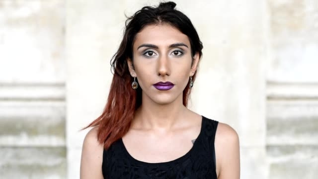 Character portrait of a young transgender female