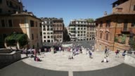 Charicaturists work at the top of the Spanish Steps in Rome Italy on Friday May 29 2015 Shots tourists descend the Spanish Steps tourists have their...