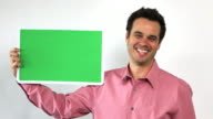 Charismatic Sales Guy With Green Screen Board, Laughing
