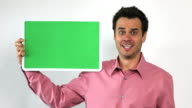 Charismatic Sales Guy With Green Screen Board, Worried