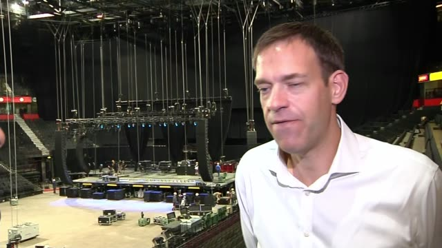 Charity concert to reopen Manchester Arena after deadly attack Reporter talking to James Allen Workersb setting up the arena for the concert Lighting...