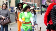 Charity Fundraisers Walking Through Town