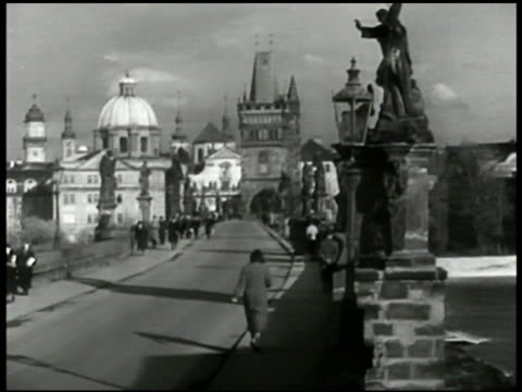 Charles Bridge in Prague pedestrians LA MS Communists hammer sickle cutout board on building INT Czech Communist meeting MS Prime Minister Klement...
