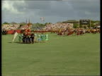 Day 5 ITN Palm Beach Polo Club GV Parade towards across pitch TMS Scots pipers towards MS Mickey Minnie Mouse ZOOM IN