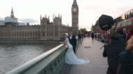 Charles Qian and his fiance Echo Li pose during a prewedding photography shoot opposite the Palace of Westminster on October 11 2016 in London...