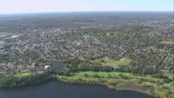 AERIAL Charles River running through suburban metropolitan area / Boston, Massachusetts, United States
