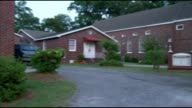 Dylann Roof charged with nine murders EXT Reverend Robert Kennedy Interior of church PULL OUT reporter talking to Kennedy Reporter and Kennedy sat on...