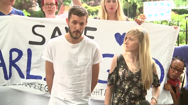 Charlie Gard's parents deliver petition to Great Ormond Street Hospital ENGLAND London EXT Connie Yates and Chris Gard along to demonstration by...