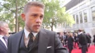 Charlie Hunnam joins director Guy Ritchie and costars Aidan Gillen and Poppy Delevingne in London's Leicester Square for the premiere of King Arthur...