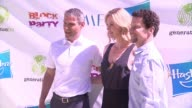 Charlize Theron Ari Emanuel and Brian Goldner at generationOn Block Party at Twentieth Century Fox Studio Lot on April 18 2015 in Los Angeles...