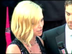 Charlize Theron at the 2005 Emmy Awards at the Shrine Auditorium in Los Angeles California on September 18 2005