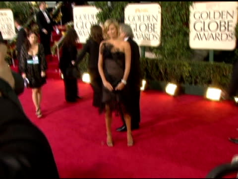 Charlize Theron at the 2006 Golden Globe Awards Arrivals at the Beverly Hilton in Beverly Hills California on January 16 2006